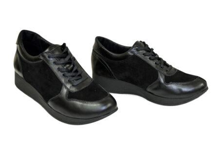 Кожаные женские кроссовки с мягким кантом и мягким языком черного цвета